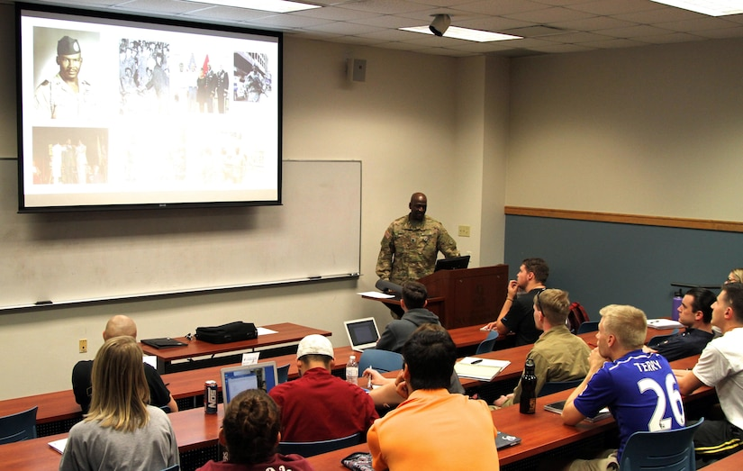 Col. Oscar Doward, Jr., commander, 2503rd Digital Liaison Detachment, U.S. Army Central, gives a lesson to students on African-American Soldiers and their participation in World War I at the University of South Carolina, Columbia.  Doward is one of 60 officers participating in the Advanced Strategic Planning and Policy Program that helps produce strategic planners and future senior leaders through a doctorate program. (U.S. Army Photo by Staff Sgt. Jared Crain)