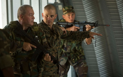 CAMP LEJEUNE, N.C. – Sgt. Travis R. Dipiazza, center, teaches room clearing techniques to role players during General Exercise 2 at Marine Corps Base Camp Lejeune, North Carolina, May 3, 2017. The Marines conducted the final rehearsal exercise of the Marine Advisor Course in order to assess their readiness to train foreign security forces during their upcoming deployment to Central America. Dipiazza is a tactics instructor with the Ground Combat Element, Special Purpose Marine Air-Ground Task Force - Southern Command. The Marine Advisor Course is taught by the Marine Corps Security Cooperation Group. (U.S. Marine Corps photo by Sgt. Ian Leones)
