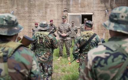 CAMP LEJEUNE, N.C. – Maj. Robert G. Gill speaks to role players at a simulated graduation ceremony during General Exercise 2 at Marine Corps Base Camp Lejeune, North Carolina, May 4, 2017. The Marines conducted the final rehearsal exercise of the Marine Advisor Course in order to assess their readiness to train foreign security forces during their upcoming deployment to Central America. Gill is the officer in charge of the Ground Combat Element, Special Purpose Marine Air-Ground Task Force - Southern Command. The Marine Advisor Course is taught by the Marine Corps Security Cooperation Group. (U.S. Marine Corps photo by Sgt. Ian Leones)