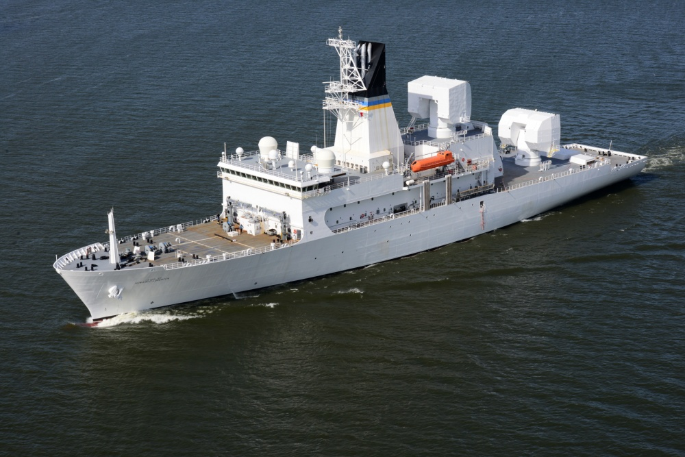 The USNS Howard O. Lorenzen (T-AGM-25) passes Astoria, Ore., as it departs the Columbia River into the Pacific Ocean, May 16, 2014. The USNS Howard O. Lorenzen is named for the late Naval Research Laboratory electrical engineer who was instrumental in the creation of the electronic intelligence capabilities of the United States. (U.S. Coast Guard photo by Petty Officer 1st Class David Mosley)