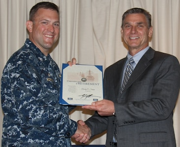 VIRGINIA BEACH, Va.  (May 18, 2017) - Bobby Starks is awarded a certificate of retirement from federal service by Cmdr. Andrew J. Hoffman, Commanding Officer of Combat Direction Systems Activity Dam Neck. Starks retired after more than 34 years as a Navy civilian.