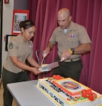 Marine Corps Col. A. J. Manuel, Defense Logistics Agency Aviation Marine Corps logistics lead, serves cake to Marine Corps Staff Sgt. Elizabeth Najieb, a V-22 weapon system customer account specialist, Marine Division, Customer Operations Directorate, DLA Aviation, during the DLA Aviation Marine Corps' 105th aviation birthday celebration held May 22, 2017 in the Center Restaurant on Defense Supply Center Richmond, Virginia.  The cake was made by Juan Delvalle, a retired food service Marine instructor from Fort Lee, Virginia's Marine Corps Detachment Food Service School.