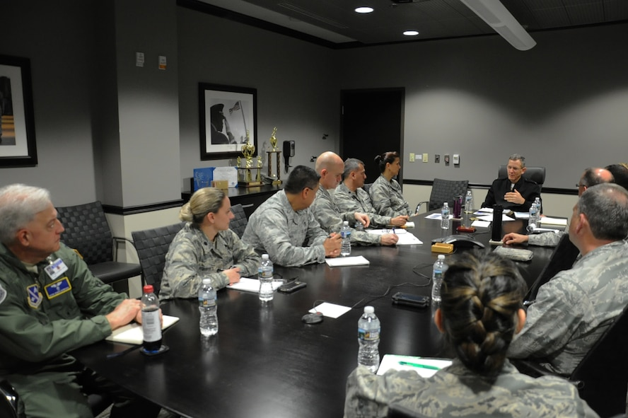 Rear Adm. David A. Lane (fourth from right), National Capital Region (NCR) Medical Directorate director, Defense Health Agency, meets with 779th Medical Group leaders May 24, 2017 at Joint Base Andrews, Md. During the meeting, They discussed the director's vision regarding how Malcolm Grow Medical Clinics and Surgery Center fit into the NCR construct,  how the National Defense Authorization Act will affect the region's medical services and how he can support the 779th Medical Group. (U.S. Air Force photo by Staff Sgt. Joe Yanik)