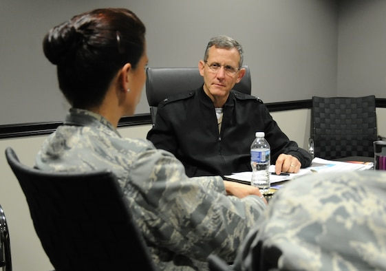Rear Adm. David A. Lane (right), National Capital Region (NCR) Medical Directorate director, Defense Health Agency, listens to Col. Leslie A. Knight , 779th Medical Group commander, during his visit May 24, 2017 at Joint Base Andrews, Md. During the meeting, the director discussed his vision regarding how Malcolm Grow Medical Clinics and Surgery Center fit into the NCR construct, how the National Defense Authorization Act will affect the region's medical services, and how he can support the 779th Medical Group. (U.S. Air Force photo by Staff Sgt. Joe Yanik)
