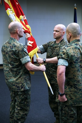 Brig. Gen. Kevin M. Iiams, the outgoing commander of U.S. Marine Corps Forces, South,  passes the unit colors to Maj. Gen. David G. Bellon during the unit's change of command ceremony in Doral, Florida, May 22, 2017. Iiams is set to become the next commander of U.S. Marine Corps Training and Education Command. (U.S. Marine Corps photo by Gunnery Sgt. Zachary Dyer)