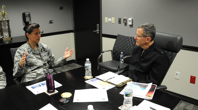 Rear Adm. David A. Lane (right), National Capital Region (NCR) Medical Directorate director, Defense Health Agency, listens to Col. Leslie A. Knight , 779th Medical Group commander, during his visit May 24, 2017 at Joint Base Andrews, Md. During the meeting, the director shared and took questions about his vision regarding how Malcolm Grow Medical Clinics and Surgery Center fit into the NCR construct and how the National Defense Authorization Act will affect the region's medical services. (U.S. Air Force photo by Staff Sgt. Joe Yanik)