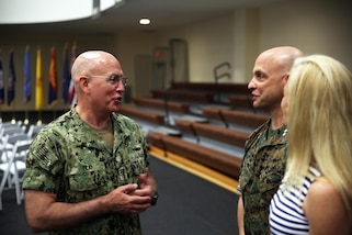 U.S. Navy Adm. Kurt W. Tidd, the commander of U.S. Southern Command, speaks to Maj. Gen. David G. Bellon, the new commander of U.S. Marine Corps Forces, South, and his wife following the unit's change of command ceremony in Doral, Florida, May 22, 2017. Brig. Gen. Kevin M. Iiams relinquished command of MARFORSOUTH to Bellon after serving as the commander since January 2016. (U.S. Marine Corps photo by Gunnery Sgt. Zachary Dyer)