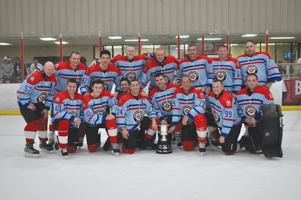 The 552nd Air Control Wing Canadian Detachment team lines up with the CAN/US Cup after defeating the Americans 5-1 in the ninth annual match-up at the Blazers Ice Center in Oklahoma City on May 12.  The series is now 6-3 Americans.