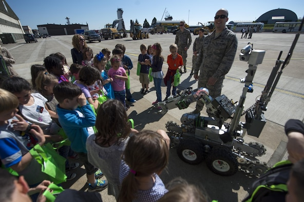 U.S. Air Force Staff Sgt. Brook Hamilton, 52nd Civil Engineer Squadron explosive ordnance disposal team member, shows children from Spangdahlem Elementary School an EOD robot during Children's Deployment Days at Spangdahlem Air Base, Germany, May 22, 2017. The event helped children better understand a deployment and included a pre-deployment brief, individual protective equipment station and multiple static displays for children to learn about. (U.S. Air Force photo by Airman 1st Class Preston Cherry)