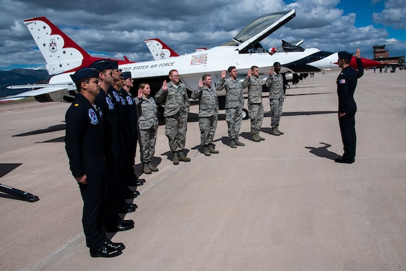 Lt. Col. Jason Heard, Thunderbird Air Demonstration Squadron commander, reenlists Airmen from the 21st Space Wing, United States Air Force Academy, Air Force Space Command and Schriever Air Station at Peterson Air Force Base, Colo., May 23, 2017. The Thunderbirds make it a point to reenlist Airmen with every visit to Peterson AFB. (U.S. Air Force photo by Robb Lingley)