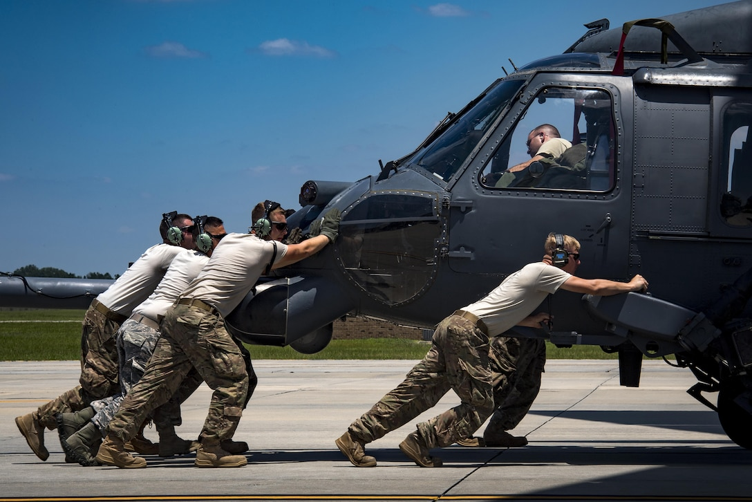 Airmen assigned to the 41st Helicopter Maintenance Unit push an HH-60G Pave Hawk into a C-17 Globemaster III, May 15, 2017,  at Moody Air Force Base, Ga. Loading the helicopter for transport was the first step in a rapid-rescue exercise conducted at Joint Base Langley-Eustis, Va., which was designed to test the maintainer's and aircrew's ability to quickly set up and conduct rescue operations away from their home station. (U.S. Air Force photo/Staff Sgt. Ryan Callaghan)