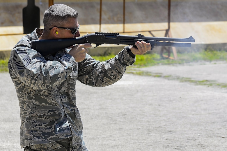 Chief Master Sgt. Jammie Space, a 36th Security Forces Squadron security forces manager, fires an M870 Modular Combat Shotgun during the leadership competition shoot off May 18, 2017,  at Andersen Air Force Base, Guam. The event was part of National Police Week which recognized the service and sacrifice of law enforcement officers. (U.S. Air Force photo/Airman 1st Class Christopher Quail)