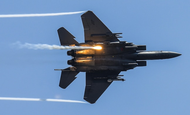An F-15E Strike Eagle releases flares as part of a combined arms demonstration during the Wings Over Wayne Air Show, May 21, 2017, at Seymour Johnson Air Force Base, N.C. The demonstration showcased both the air-to-air and air-to-ground capabilities of the Strike Eagle. (U.S. Air Force photo/Staff Sgt. Brittain Crolley)