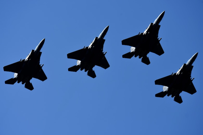 An F-15E Strike Eagle four-ship formation flies over the crowd during the Wings Over Wayne Air Show, May 20, 2017, at Seymour Johnson Air Force Base, N.C. Later this year, the 4th Fighter Wing will celebrate its 75th anniversary with a week of heritage events and ceremonies. (U.S. Air Force photo/Airman 1st Class Miranda A. Loera)
