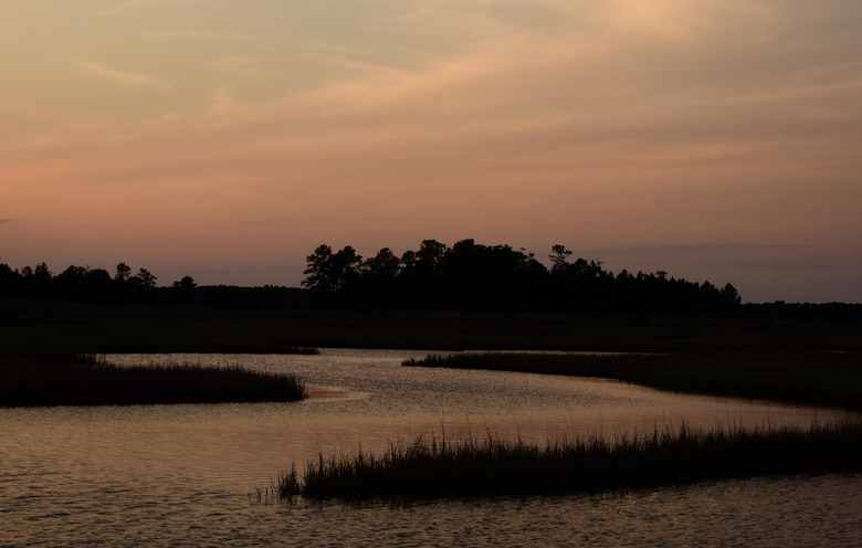 The sun sets over brackish marshes at Joint Base Langley-Eustis, Va., May 10, 2017. Brackish marshes are ideal nesting places to Diamondback Terrapin Turtles, which is a declining species. (U.S. Air Force photo by Staff Sgt. Natasha Stannard)