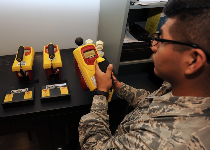 Senior Airman Velentine Orta-Bartolon, 19th Aerospace Medicine Squadron Bioenvironmental technician, calibrates a device May 18, 2017, at Little Rock Air Force Base, Ark. The equipment is calibrated by using radiation sources to detect contamination.  (U.S. Air Force photo by Airman 1st Class Grace Nichols)
