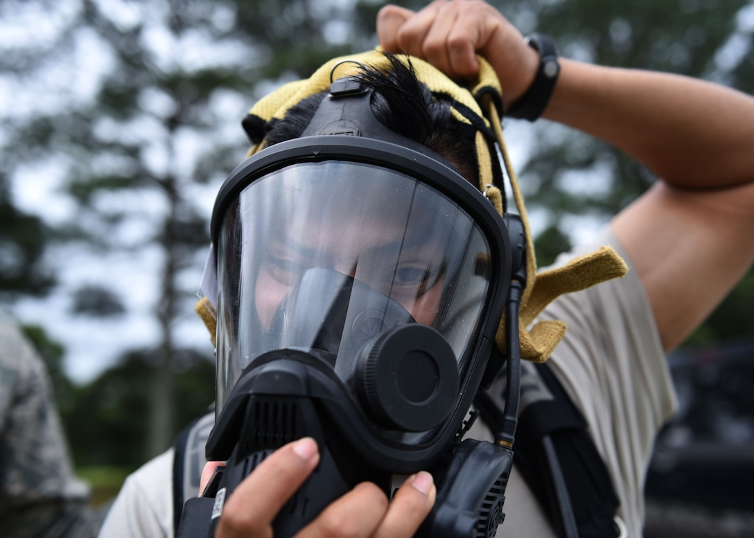 Senior Airman Velentine Orta-Bartolon, 19th Aerospace Medicine Squadron Bioenvironmental technician, dons a Level A biohazard suit May 18, 2017, at Little Rock Air Force Base, Ark. The suit protects individuals from contaminants such as harmful chemicals and radiation. (U.S. Air Force photo by Airman 1st Class Kevin Sommer Giron)