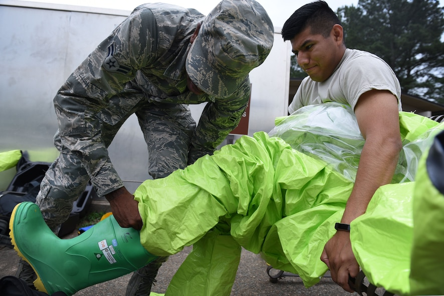Airman 1st Class Jajuan Erby, left, 19th Aerospace Medicine Squadron Bioenvironmental technician, assists Senior Airman Velentine Orta-Bartolon, 19th AMDS technician, right, don a Level A biohazard May 18, 2017, at Little Rock Air Force Base, Ark. Every tool in the bioenvironmental arsenal is strategically employed for the detection of various pollutants and radiation in the environment. (U.S. Air Force photo by Airman 1st Class Kevin Sommer Giron)