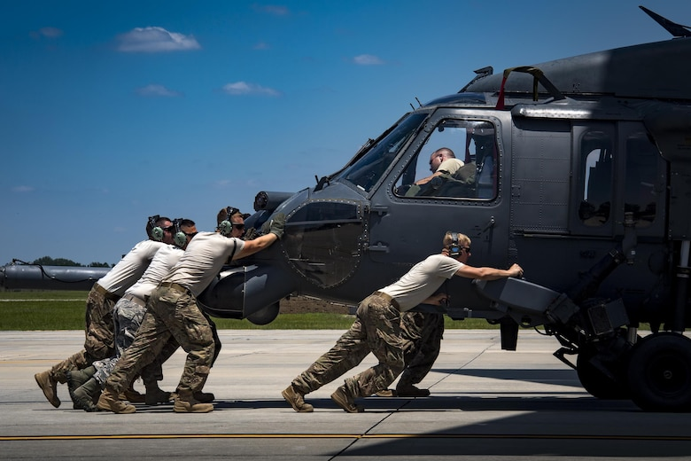 Airmen from the 41st Helicopter Maintenance Unit push an HH-60G Pave Hawk into a C-17 Globemaster III, May 15, 2017, at Moody Air Force Base, Ga. Loading the helicopter for transport was the first step in a rapid-rescue exercise conducted at Langley AFB, Va., which was designed to test the maintainer's and aircrew's ability to quickly set up and conduct rescue operations away from their home station. (U.S. Air Force photo by Staff Sgt. Ryan Callaghan)