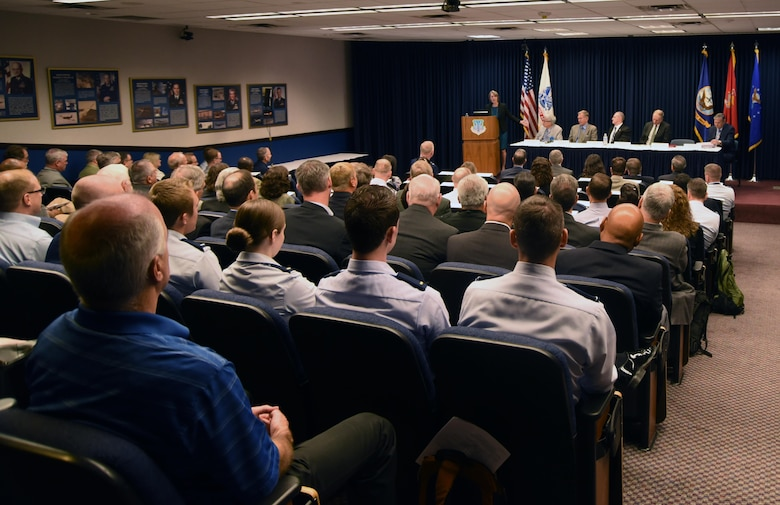 Former directors of the Department of Defense Space Test Program speak to the annual science and technology review conference at Kirtland Air Force Base, May 17. The panel of former directors fielded questions from the audience about a range of different topics.