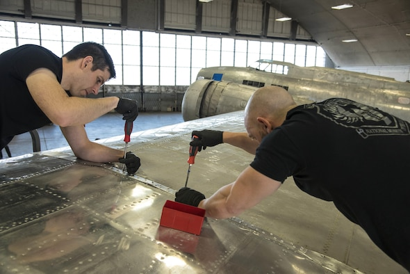 DAYTON, Ohio -- (From left to right) National Museum of the U.S. Air Force restoration specialists Casey Simmons and Chase Meredith install the final wing-tip on the Boeing B-17F Memphis Belle™ on March 22, 2017. The famed B-17F Memphis Belle™ and its crew became iconic symbols of the heavy bomber crews and support personnel who helped defeat Nazi Germany. The Memphis Belle was the first US Army Air Forces heavy bomber to return to the US after completing 25 combat missions over Europe. The USAAF chose the Memphis Belle for a highly-publicized war bond tour from June-August 1943, and its crew was celebrated as national heroes. The aircraft and crew were also the subject of two widely-seen Hollywood movies (one in 1944 and another in 1990). The Memphis Belle will be placed on public display at the museum on May 17, 2018. (U.S. Air Force photo by Ken LaRock)