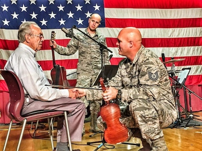 TSgt Jason Cale, a member of the USAF Heritage of America Band's Blue Aces, works with a veteran at the Salem, Virginia Veterans Medical Center.  The band was assisting a board-certified music therapist while on a 4-day mission to the center.