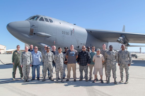 Brig. Gen. Carl E. Schaefer (second from left), 412th Test Wing commander, poses for a group photo after presenting challenge coins to 912th Aircraft Maintenance Squadron personnel on behalf of Gen. Ellen M. Pawlikowski, commander of Air Force Materiel Command. Pawlikowski issued the coins as thanks for efforts undertaken to make her flight possible aboard a B-52 Stratofortress during a sortie earlier in May. (U.S. Air Force photo by Christopher Okula)