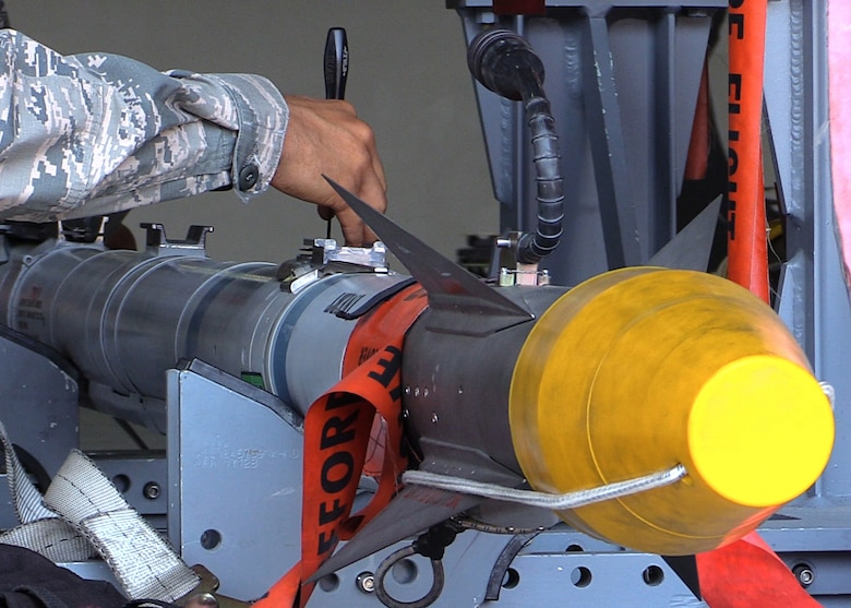 U.S. Air Force Senior Airman Christopher Lewis, 1st Maintenance Group weapons standardization lead crew member, prepares an AIM-9X missile to be loaded onto an F-22 Raptor, at Joint Base Langley-Eustis, Va., April 19, 2017. Compared to the older AIM-9M, the AIM-9X maneuvers easier, picks up heat signatures better and is a safer weapon overall. (U.S. Air Force photo/Airman 1st Class Amanda Dole)