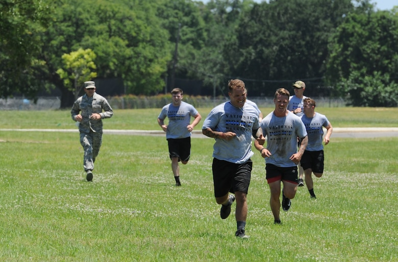 Members of the 81st Security Forces Squadron team run the last leg of the 81st SFS obstacle course competition May 16, 2017, on Keesler Air Force Base, Miss. The competition was held during National Police Week, which recognizes the service of law enforcement men and women. (U.S. Air Force photo by Kemberly Groue)