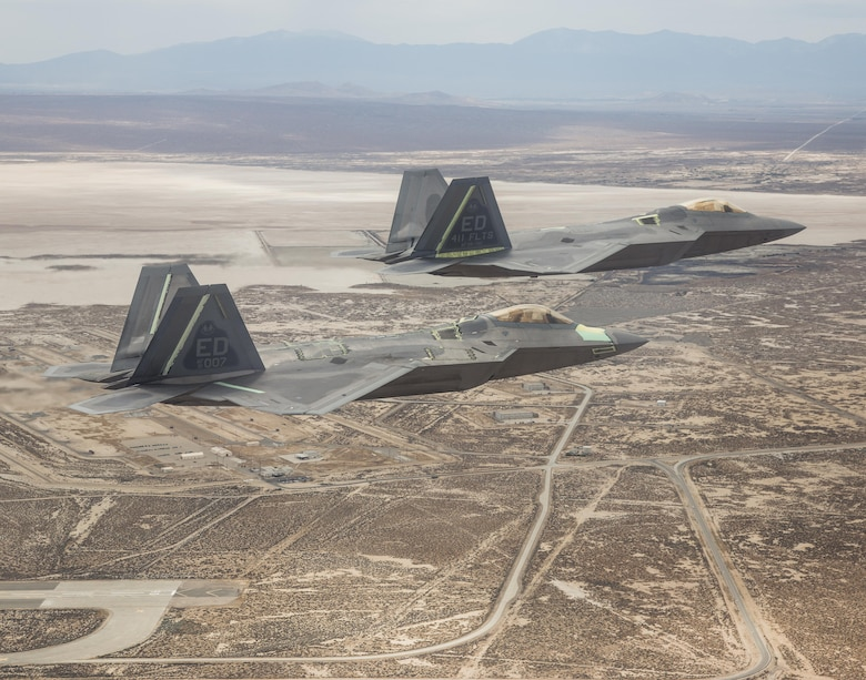 Two F-22 Raptors from the 411th Flight Test Squadron fly over Edwards Air Force Base, California. (Courtesy photo by Chad Bellay/Lockheed Martin)