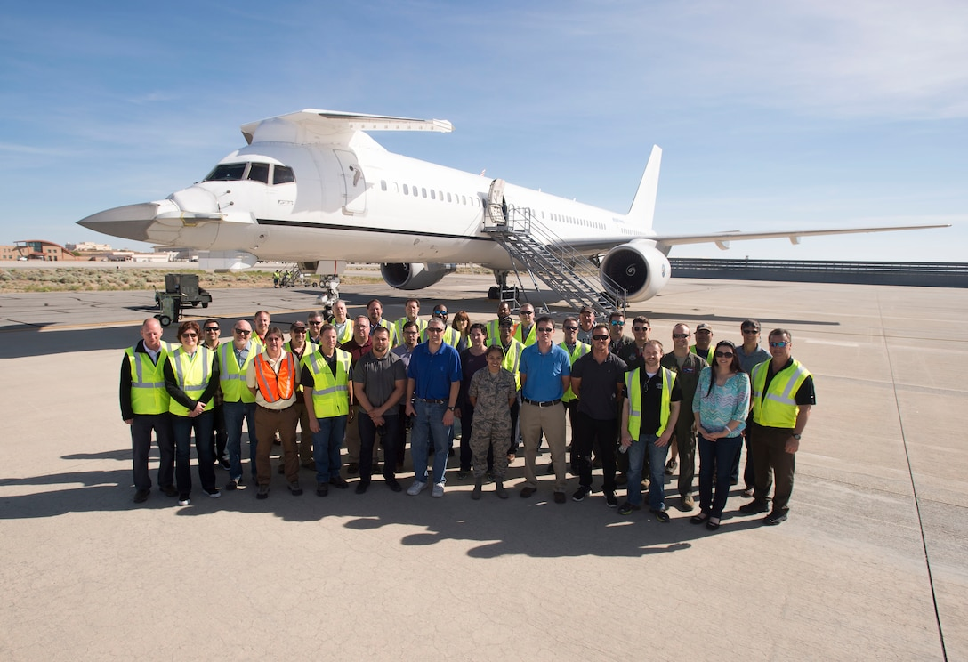 Members of the F-22 Flying Test Bed team pose for a photo in front of the highly modified Boeing 757 May 3. The FTB routinely flies with real Raptors both at Edwards and Nellis Air Force Base, Nevada in order to gain an early look at F-22 mission software before the software is released to developmental flight test, mainly at Edwards. The FTB can fly up to 30 crewmembers. (U.S. Air Force photo by Ethan Wagner)