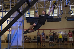 Kevin Klein, Alpha Warrior athlete, demonstrates obstacles  on the Alpha Warrior Battle Rig at Joint Base McGuire-Dix-Lakehurst, N.J. May 23. Alpha Warrior athletes are touring Air Force Bases Promoting Functional Fitness and obstacle training.