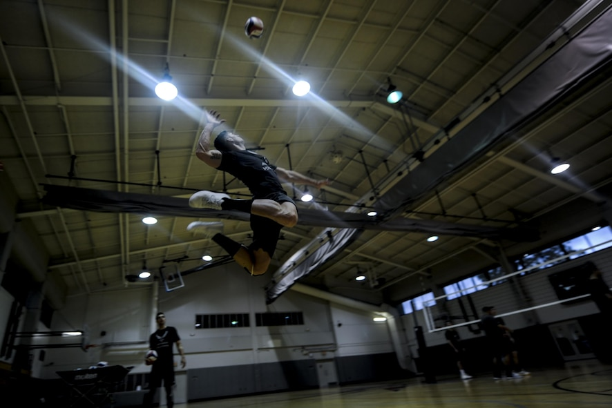 Staff Sgt. Nicholas Parker, an outside hitter with the Air Force men's volleyball teams, serves a volleyball during practice at Hurlburt Field, Fla., May 23, 2017. Parker is assigned to the 564th Aircraft Maintenance Squadron at Tinker Air Force Base, Okla.  (U.S. Air Force photo by Airman 1st Class Dennis Spain)