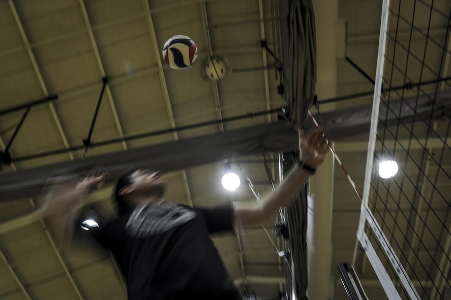 Capt. Karl Grosselin, the coach of the Air Force men's volleyball team, serves a volleyball during practice at Hurlburt Field, Fla., May 23, 2017. Grosselin is assigned to the Space Superiority Directorate at Los Angeles Air Force Base, Calif. (U.S. Air Force photo by Airman 1st Class Dennis Spain)