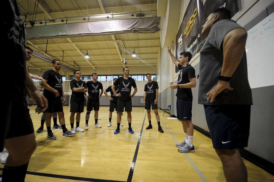 The Air Force men's volleyball team discusses practice at Hurlburt Field, Fla., May 23, 2017. Out of more than 50 applicants, 18 Airmen tried out and 12 Airmen made the team for the 2017 season. (U.S. Air Force photo by Airman 1st Class Dennis Spain)