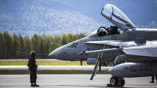 A U.S. Marine with Marine Fighter Attack Squadron (VMFA) 232 prepares an F/A-18C prior to conducting flight operations at Joint Base Elmendorf-Richardson, Alaska, May 24, 2017. VMFA 232 is participating in exercise Distant Frontier, which is a unit-level training iteration designed to sharpen participants' tactical combat skills and develop interoperable plans and programs across the joint force. (U.S. Marine Corps Photo by 1st Lt. Melissa M. Heisterberg)