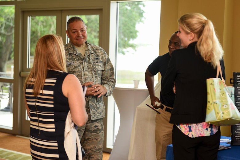 Master Sgt. John Fusco, an in-service recruiter assigned to the 1st Special Operations Force Support Squadron, meets with potential candidates during the 2017 Career Symposium at the Soundside Club, Hurlburt Field, Fla., May 24, 2017. In-service recruiters are career counselors who meet with Airmen separating from active duty and offer opportunities within the Air force Reserves (U.S. Air Force photo by Staff Sgt. Jeff Parkinson)