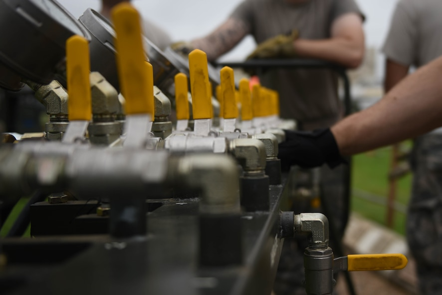 Airmen from 2nd Maintenance Group use an air manifold during an aircraft lift at Barksdale Air Force Base, La., May 23, 2017. An air manifold is used to fill bags with air which raise the static aircraft off the ground. (U.S. Air Force photo/Airman 1st Class Stuart Bright)
