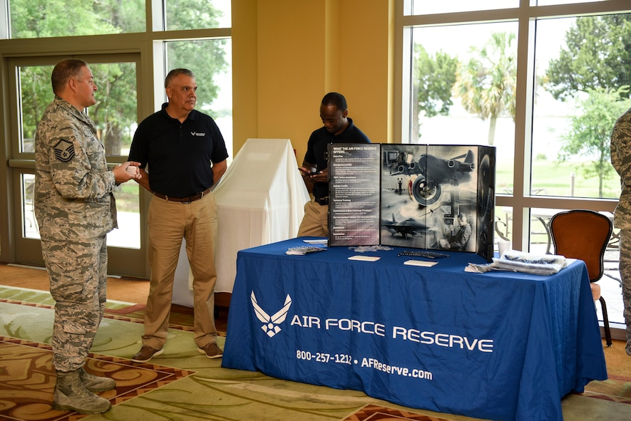 Master Sgts. John Fusco, left, and Michael Perkins, in-service recruiters assigned to the 1st Special Operations Force Support Squadron, wait to meet with potential candidates during the 2017 Career Symposium at the Soundside Club, Hurlburt Field, Fla., May 24, 2017. In-service recruiters provide Airmen separating from active duty with information on opportunities and benefits offered in the Air Force Reserves. (U.S. Air Force photo by Staff Sgt. Jeff Parkinson)