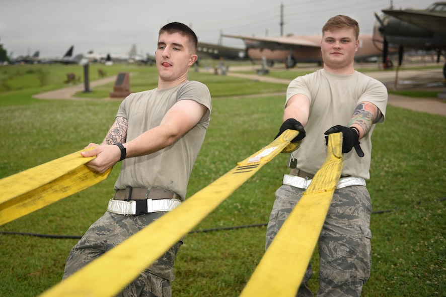 Airman 1st Class Daniel Munday and Kyle Thomsen, 2nd Maintenance Squadron repair and reclamation section journeymen, help strap down a static SR-71 Blackbird at the Global Air Power Museum at Barksdale Air Force Base, La., May 23, 2017. The lift gave 2nd Maintenance Group Airmen who needed the necessary training to stay qualified to conduct aircraft lifts. (U.S. Air Force photo/Airman 1st Class Stuart Bright)