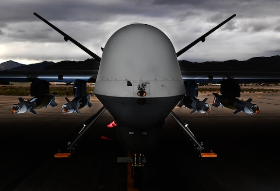 An MQ-9 Reaper, loaded with four GBU-12 Paveway II laser-guided bombs is ready for a training mission March 31, 2017, at Creech Air Force Base, Nev. The MQ-9, matched with a skilled aircrew, provides persistent attack and reconnaissance capabilities 24/7/365. (U.S. Air Force photo/Senior Airman Christian Clausen)
