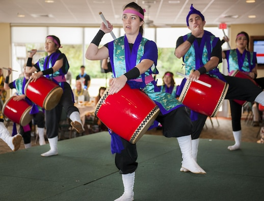 "Taiko drummers perform a traditional Japanese song at the Asian and Pacific Islander Heritage Luncheon May 24 at Eglin Air Force Base, Fla.  The base community was treated to an afternoon filled with entertainment, education and Asian-Pacific cuisine.  This year's theme was ""Unite Our Voices by Speaking Together.""  (U.S. Air Force photo/Kevin Gaddie)"