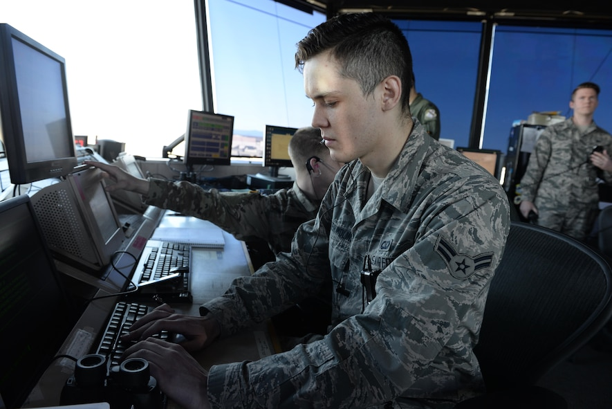 U.S. Air Force Airman 1st Class Kevin Winter-Molins, a 354th Operations Support Squadron air traffic controller, types commands into a computer April 20, 2017, at Eielson Air Force Base, Alaska. Winter-Molins was born in Mexico before moving to the U.S. and later joining the Air Force. (U.S. Air Force photo by Airman Eric M. Fisher)