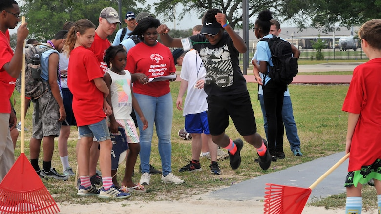 Nicholas Berry, a Special Olympics athlete, competes in the standing long jump during the Special Olympics Mississippi 2017 Summer Games May 20, 2017, on Keesler Air Force Base, Miss. This was Berry's first trip to the state games, where he competed in the 200-meter dash and the standing long jump. He earned a silver medal in the dash and a gold medal in the long jump. (U.S. Air Force photo by Senior Airman Jenay Randolph)