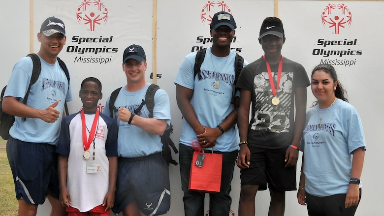 Airmen sponsors and athletes pause for a photo during the Special Olympics Mississippi 2017 Summer Games May 20, 2017, on Keesler Air Force Base, Miss. Keesler hosted more than 3,200 athletes, directors, coaches, family members and volunteers spanning over 16 regions across Mississippi for the 31st year. (U.S. Air Force photo by Senior Airman Jenay Randolph)