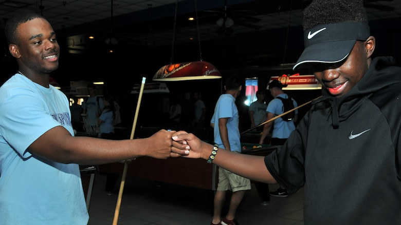 Airman Basic Tyshon Singletary, 335th Training Squadron personnel student, gives Nicholas Berry, Area 11 athlete, a fist bump during the Special Olympics Mississippi 2017 Summer Games May 20, 2017, on Keesler Air Force Base, Miss. Singletary and Berry built a friendship during the two-day event after hanging out and getting to know each other. (U.S. Air Force photo by Senior Airman Jenay Randolph)