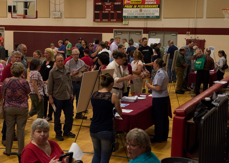Local residents seek additional information about groundwater contamination at booths manned by local health, science and administrative authorities at Medical Lake High School, Medical Lake, Wash. May 23, 2017. Fairchild Air Force Base leadership and environmental specialists, in an act of transparency to the local community, arranged a public meeting and information-sharing session to help inform residents. (U.S. Air Force photo / Airman 1st Class Ryan Lackey)