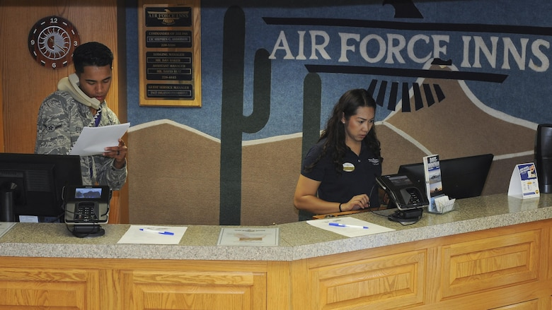 U.S. Air Force Airman Zachary Stratton and Cristina Byrd, 355th Force Support Squadron guest service representatives, confirm a reservation at the Air Force Inns at Davis-Monthan Air Force Base, Ariz., May 19, 2017. The guest service desk takes reservations, checks guests in and out of lodging, and provides directions to new guests. (U.S. Air Force photo by Senior Airman Ashley N. Steffen)