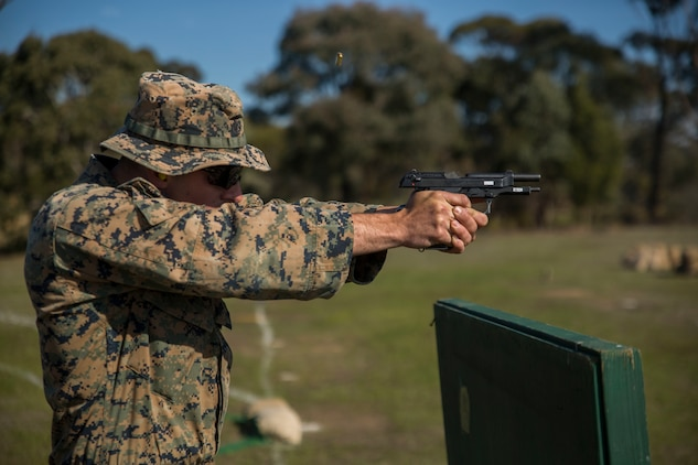 Sgt. Johnathon Solinsky fires his last shot during a pistol match, May 16, 2017, at the Australian Army Skills at Arms Meeting, in Puckapunyal, Australia. The meet brings together roughly 20 different countries to compete against each other. Solinsky, a native of Tucson, Arizona, is an instructor with the Marine Corps Rifle Team, based out of Marine Corps Base Quantico, Virginia. (U.S. Marine Corps photo by Lance Cpl. Bernadette Wildes)