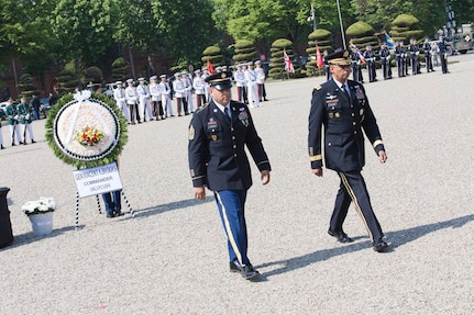 Gen. Vincent K. Brooks, United Nations Command, Combined Forces Command and United States Forces Korea commanding general, and Sgt. Maj. Luis H. Freyre Jr., USFK operations sergeant major, walk away after laying a wreath during a Memorial Day Honor Guard Ceremony at Knight Field, in front of the USFK headquarters near Seoul South Korea, South Korea, May 25. The ceremony recognized all fallen service members but focused on the sacrifices made in the defense of South Korea. (U.S. Army photo by Sgt. 1st Class Sean K. Harp, USFK Public Affairs)